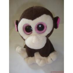 Nagyszemű plüss majom